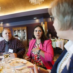 David Starling, Provo City School District business teacher, and his wife, Gladys Aguirre Starling, talk with Karen McMullin, investor education coordinator with the Utah Division of Securities, at The Stock Market Game student awards banquet in Salt Lake City on Friday, May, 13, 2016.
