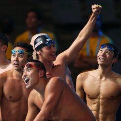 Ryosuke Irie, Kosuke Kitajima, Takuro Fujii and Shinri Shioura of Japan celebrate after the USA are disqualified and they are instated as bronze medal   winners of the Swimming Men's Medley 4x100m Relay Final.