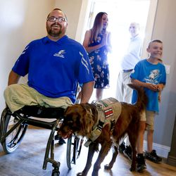 Purple Heart veteran U.S. Army Sgt. 1st Class Travis Vendela, left, his wife, Tiffany, Andrew McClure, Tunnel to Towers national community engagement coordinator, and Quentin Vendela, enter the Vendelas' new home in Huntsville, Weber County, on Friday, July 3, 2020.