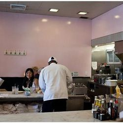"""Pink walls, bar stools, and lines out the door. Camellia Grill courtesy of <a href=""""http://www.flickr.com/photos/eaternola/8019603401/in/photostream"""">Flickr/EaterNOLA</a>"""