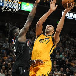 Utah Jazz center Rudy Gobert (27) shoots over the extended arms of Houston Rockets center Clint Capela (15) as the Utah Jazz host the Houston Rockets at Vivint Smart Home Arena in Salt Lake City on Thursday, Dec. 7, 2017.