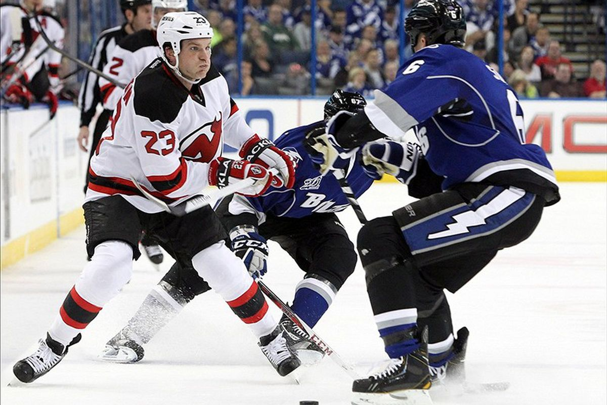 The Lightning's Sami Salo defends against New Jersey 's David Clarkson during Friday night's 5-4 shootout win at the Tampa Bay Times Forum