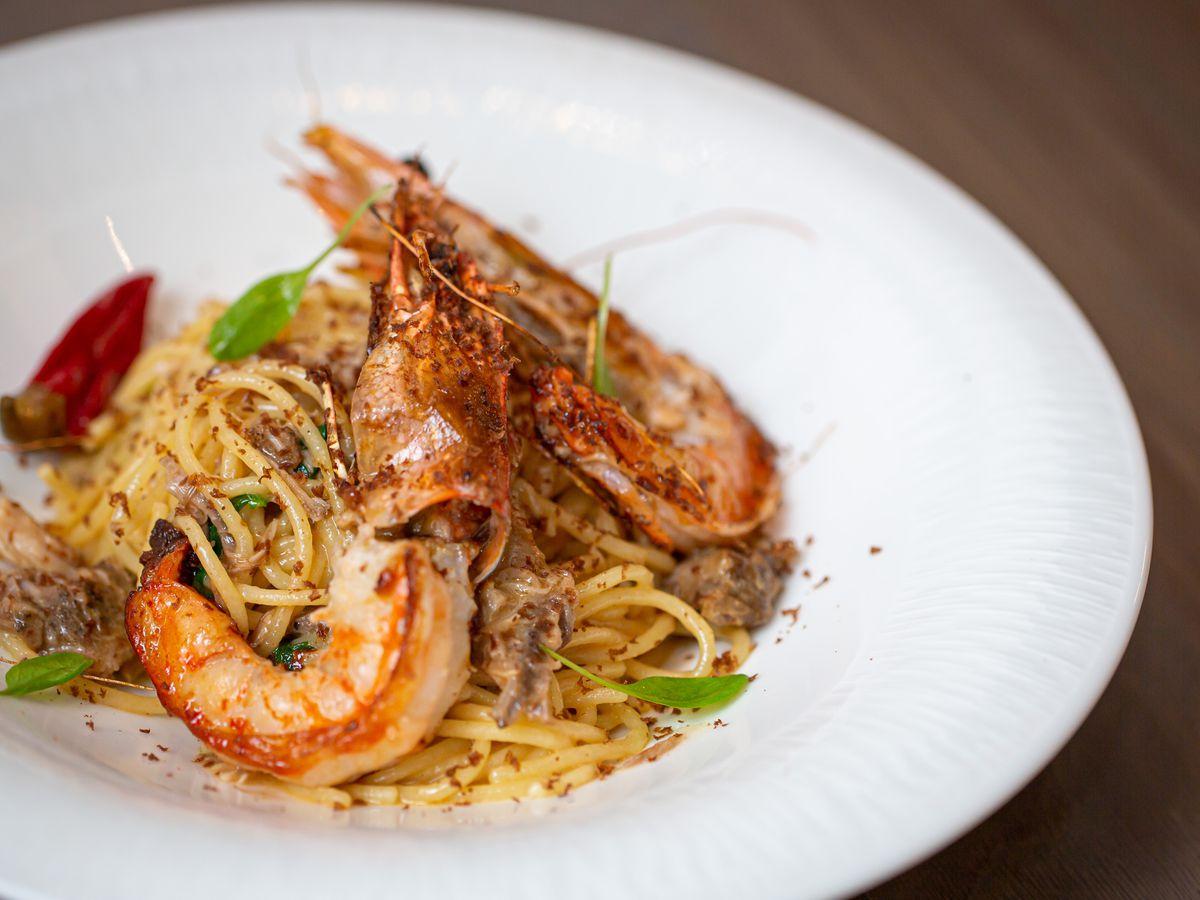 Two heads-on jumbo shrimp over spaghetti and bortaga