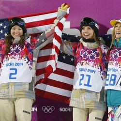 From left, bronze medalist United States' Kelly Clark, gold medalist United States' Kaitlyn Farrington and silver medalist Australia's Torah Bright pose following the women's snowboard halfpipe at the Rosa Khutor Extreme Park at the 2014 Winter Olympics, Wednesday, Feb. 12, 2014, in Krasnaya Polyana, Russia.(AP Photo/Sergei Grits)