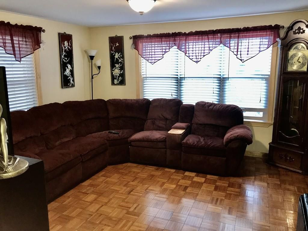 A sectional couch in the corner of a living room.