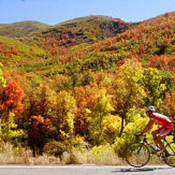 Kevin VanLoon takes advantage of beautiful weather and scenery as he cycles through Emigration Canyon on Monday, a day before the fall equinox.