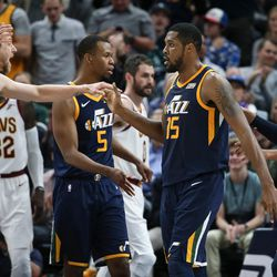 Utah Jazz forward Joe Ingles (2) congratulates forward Derrick Favors (15) after an and-one dunk over the Cleveland Cavaliers at Vivint Arena in Salt Lake City on Saturday, Dec. 30, 2017.