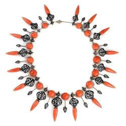 Kentshire Galleries, Ltd. An antique coral fringe necklace of Moorish style, with graduated amphorae pendants and black enamel decoration, in silver gold. Petiteau, France, c. 1850.