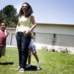 """Jessica Gomez and her children Jonah, 7, and Ellie, 5, were selected to receive a new home from """"Extreme Makeover: Home Edition."""""""