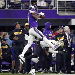 Minnesota Vikings wide receiver Stefon Riggs (14) makes a catch over New Orleans Saints free safety Marcus Williams (43) on his way to the game winning touchdown during the second half of an NFL divisional football playoff game in Minneapolis, Sunday, Jan. 14, 2018. The Vikings defeated the Saints 29-24. (AP Photo/Jeff Roberson)