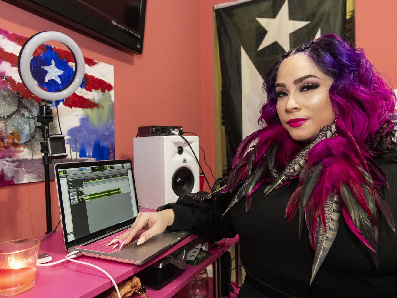 Hip-hop artist Pinqy Ring sits in her home recording studio in the Logan Square neighborhood, Friday, Dec. 18, 2020.