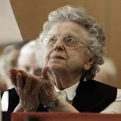 In this April 10, 2012, photo, sister Bertha Duperry, 96, reaches out to take communion during Mass at St. Joseph Convent n Biddeford, Maine. Good Shepherd Sisters of Quebec has just six convents in Maine and Massachusetts with fewer than 60 sisters. The youngest is 64, and it's been more than 20 years since a new member has joined. Sister Elaine Lachance is using the Internet, social media and even a blog to attract women who feel the calling to serve God.