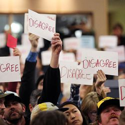 Many of those in attendance hold signs during a town hall meeting with Rep. Jason Chaffetz in Cottonwood Heights on Thursday, Feb. 9, 2017.
