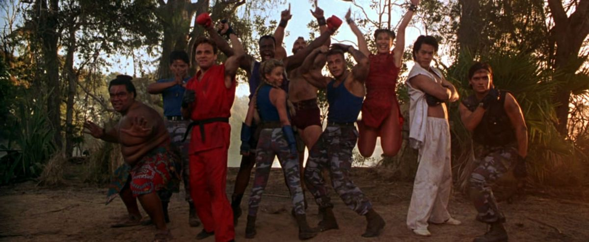 Ensemble freeze frame shot of the cast of Street Fighter including Jean-Claude Van Damme, Ming-Na Wen, Kylie Minogue, and Byron Mann