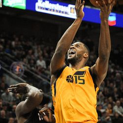 Utah Jazz forward Derrick Favors (15) shoots over Houston Rockets guard James Harden (13) as the Utah Jazz host the Houston Rockets at Vivint Smart Home Arena Salt Lake on Thursday, Dec. 7, 2017.