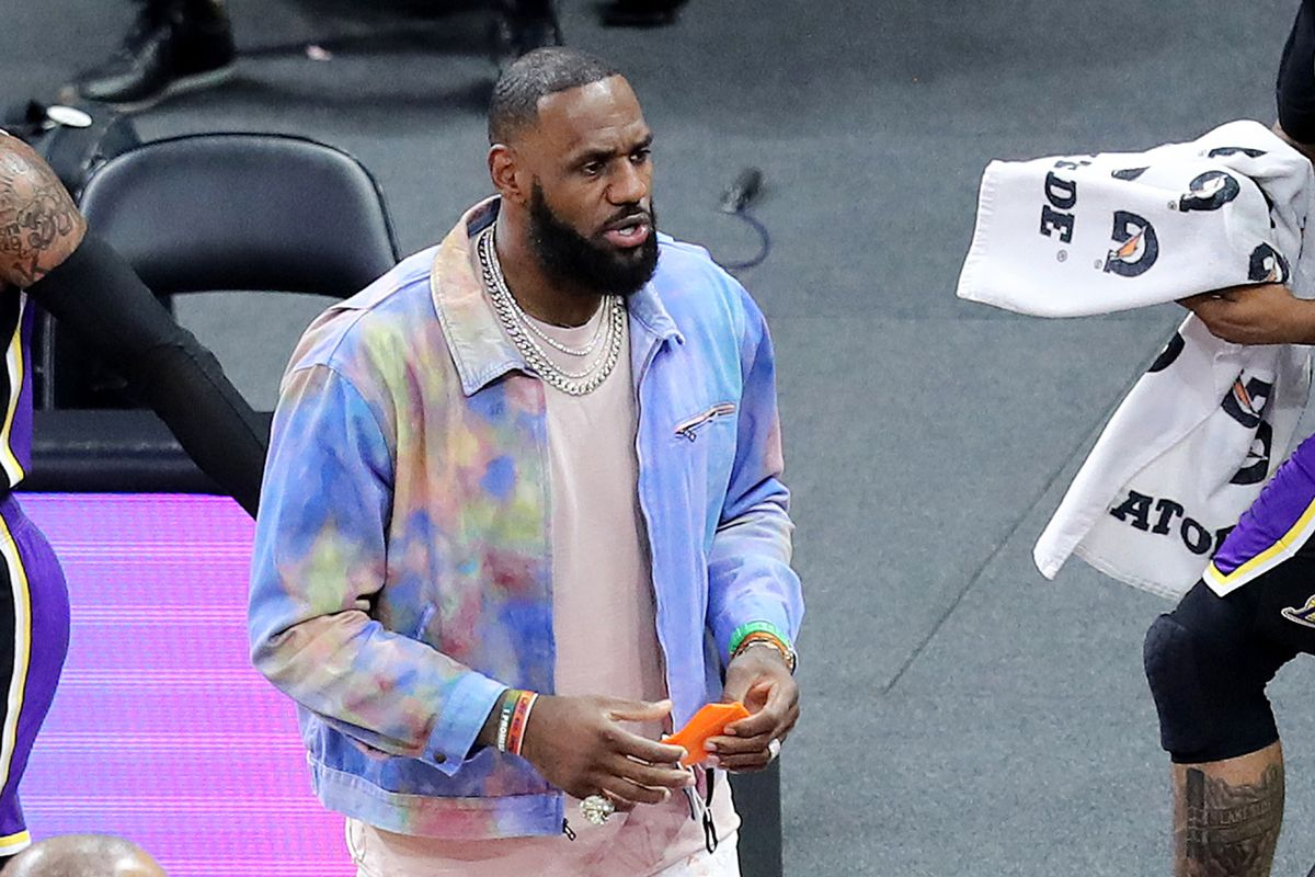 Injured player LeBron James of the Los Angeles Lakers is seen on the court during a game against the Orlando Magic at Amway Center on April 26, 2021 in Orlando, Florida.