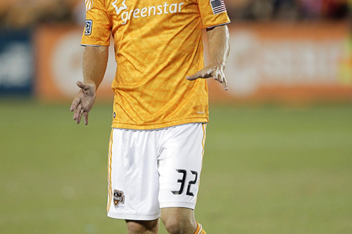 HOUSTON - OCTOBER 23:  Bobby Boswell #32 of the Houston Dynamo celebrates after scoring in the 48th minute against the Los Angeles Galaxy at Robertson Stadium on October 23, 2011 in Houston, Texas. Houston won 3-1. (Photo by Bob Levey/Getty Images)