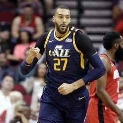 Utah Jazz center Rudy Gobert (27) reacts after scoring a basket during the first half of an NBA basketball game against the Houston Rockets, Sunday, Feb. 9, 2020, in Houston.