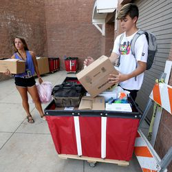 Heather Boland and her brother, Garrett Boland, move her belongings into her dorm at the University of Utah in Salt Lake City on Thursday, Aug. 17, 2017.