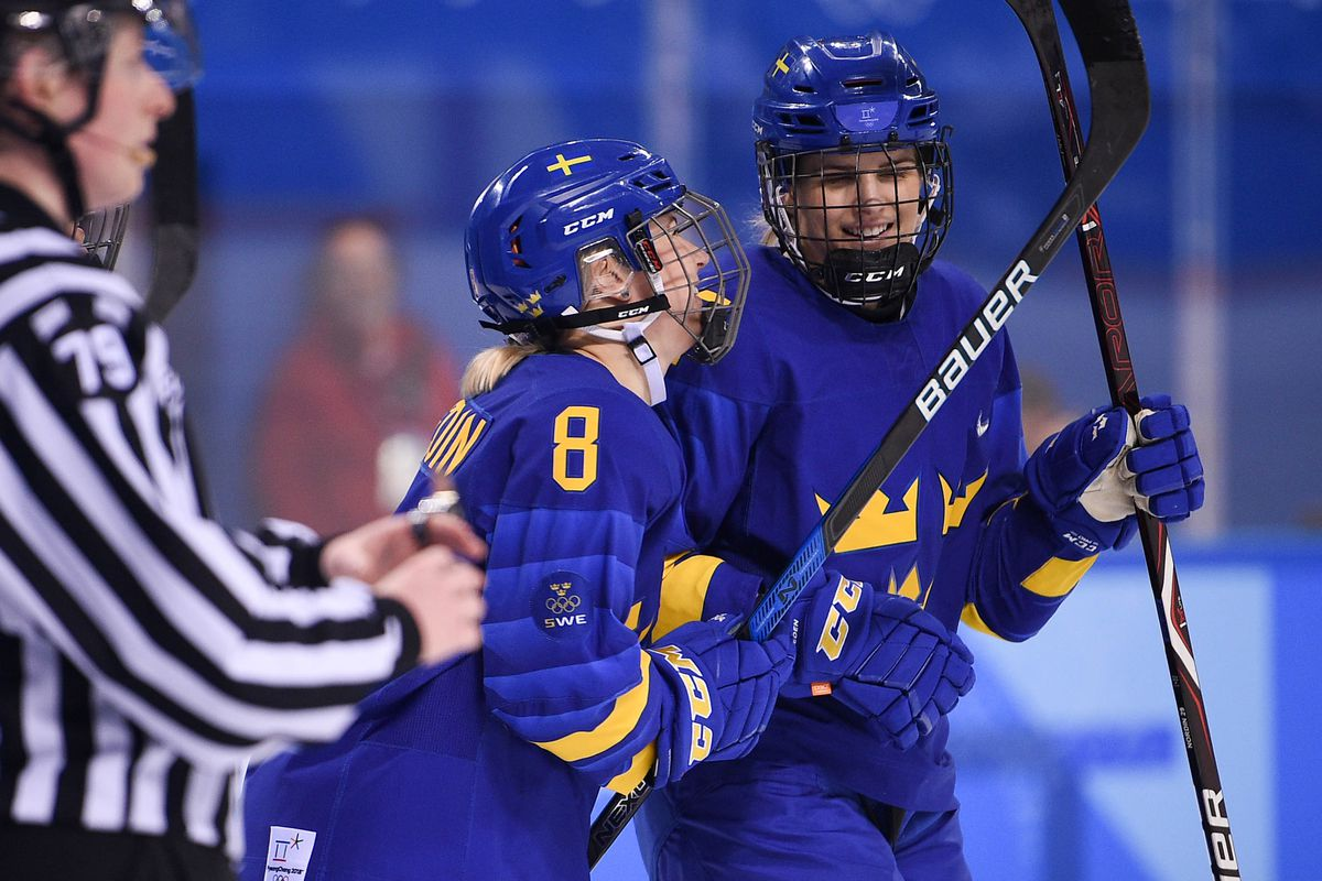 Sweden forward Erika Grahm (24) and defender Annie Svedin (8) react after Grahm scores a goal on Korea goaltender So Jung Shin during the Pyeongchang 2018 Olympic Winter Games.