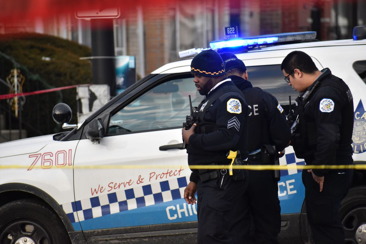 Chicago police investigate a scene where a man and woman was shot to death March 1, 2020, in Chatham.