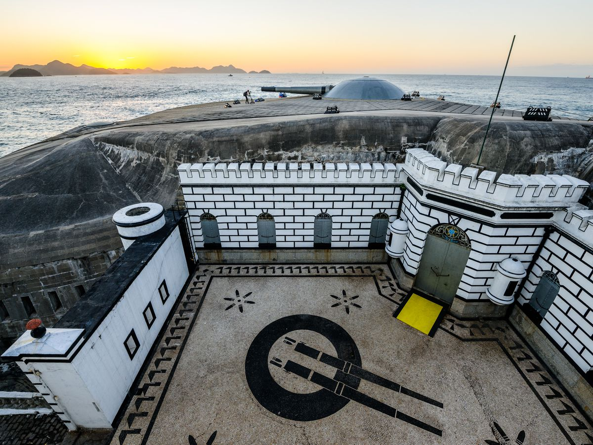 An aerial view of Fort Copacabana in Rio de Janeiro. The fort's facade is white brick and there is a courtyard.