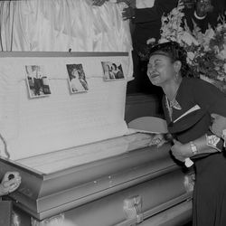 Funeral for Emmett Till. Mother of Emmett Till, Mamie Mobley pauses at the casket at A.A.Raynor funeral home.