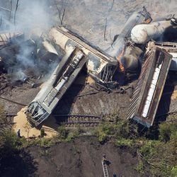 FILE - This July 11, 2012 aerial file photo, a freight train is seen after an early morning derailment in Columbus, Ohio. Part of the freight train carrying ethanol derailed and caught fire, shooting flames skyward into the darkness and prompting the evacuation of a mile-wide area as firefighters and hazardous materials crews monitored the blaze. For two decades, one of the nation's most common types of rail tanker, known as a DOT-111, a workhorse of the American rail fleet, has been allowed to haul hazardous liquids from coast to coast even though transportation officials were aware of a dangerous design flaw that almost guarantees the car will tear open in an accident. The rail and chemical industries have committed to a safer design for new tankers, but they do not want to modify tens of thousands of existing cars. That's despite a spike in the number of accidents.