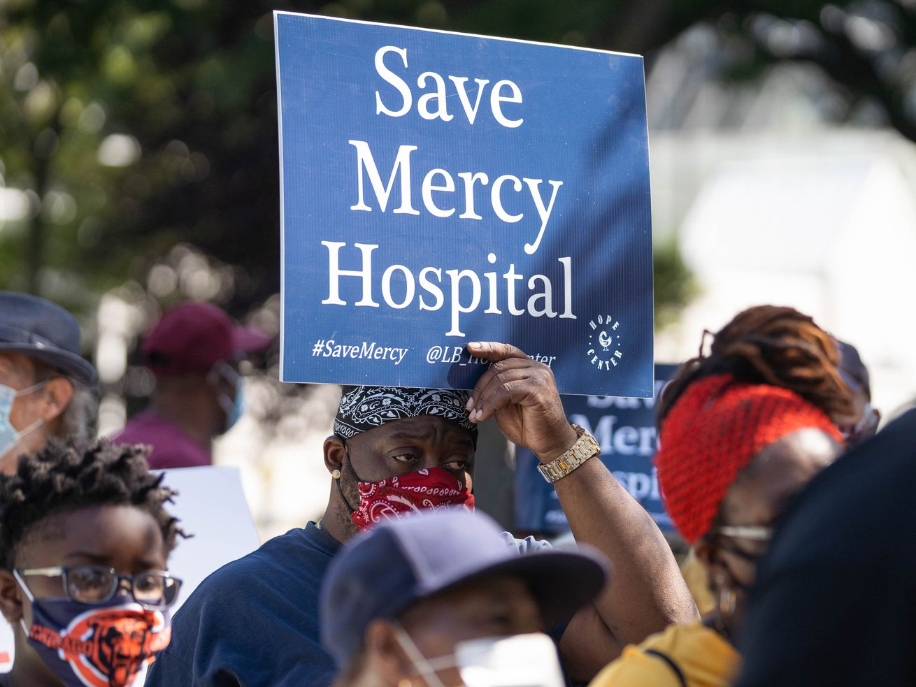 Local officials, community activists and Mercy Hospital and Medical Center employees attend a protest outside Mercy Hospital and Medical Center in Bronzeville Thursday morning, Sept. 3, 2020. They demanded Gov. J.B. Pritzker and Mayor Lori Lightfoot to keep the hospital open, saying its closure will further increase the inequities in Black and Brown communities. The facility is set to close in 2021. | Pat Nabong/Sun-Times