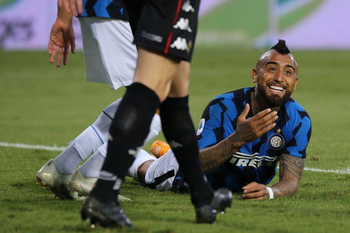 Inter Milan's Chilean midfielder Arturo vidal gestures...
