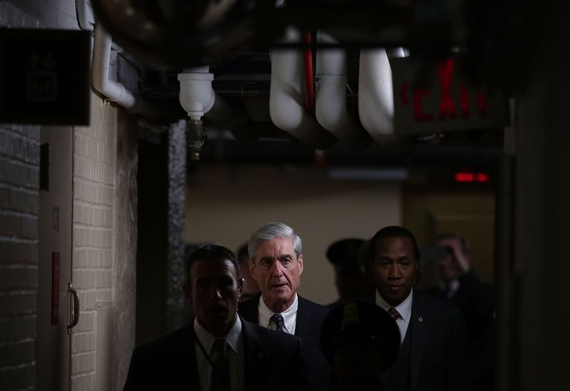 Special counsel Robert Mueller (C) leaves after a closed meeting with members of the Senate Judiciary Committee June 21, 2017 at the Capitol in Washington, DC. The committee meets with Mueller to discuss the firing of former FBI Director James Comey.
