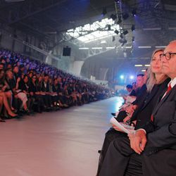 Lubov and Max Azria watch the AAU runway show