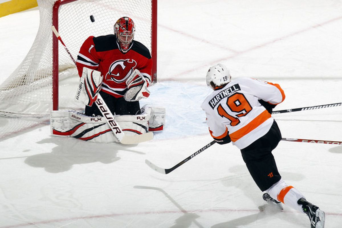 An actual save by Johan Hedberg against Scott Hartnell.  Let's discuss the 12 goals allowed by Hedberg in all of January 2011 instead. (Photo by Bruce Bennett/Getty Images)