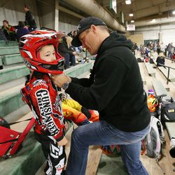 Connor Clifford, 6, gets some help from his dad, Lance, prior to racing BMX in South Jordan on Dec. 6, 2015.