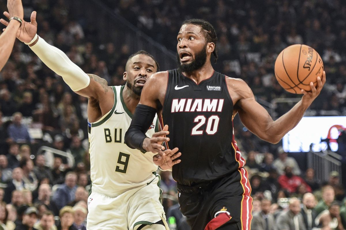 Miami Heat forward Justise Winslow drives for the basket against Milwaukee Bucks guard Wesley Matthews in the second quarter at Fiserv Forum.
