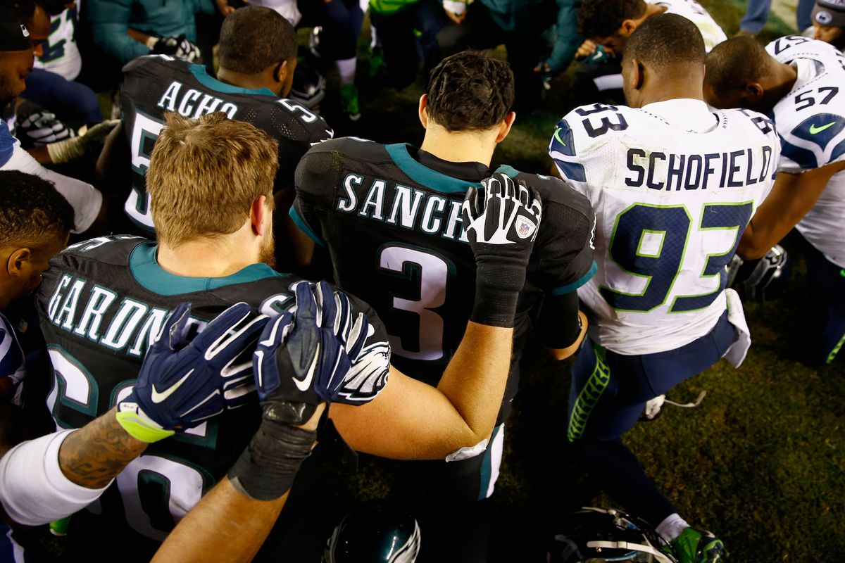 Players from the Seattle Seahawks and the Philadelphia Eagles during the post-game prayer at Lincoln Financial Field on December 7, 2014 in Philadelphia, Pennsylvania.