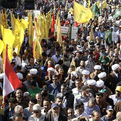 Tens of thousands of people take part in Lebanon's eastern city of Baalbek, Lebanon, Friday, Sept. 21, 2012, for the latest in a series of protest rallies organized by the Shiite militant group Hezbollah. Anger over insults to Islam's Prophet Muhammad isn't enough to bring Lebanon's divided Sunni and Shiite Muslims together. The two sects, which have been locked in sometimes violent political competition, hold separate protests. A hardline Sunni cleric accuses Shiite Hezbollah of using the protests to distract from the fighting in neighboring Syria.
