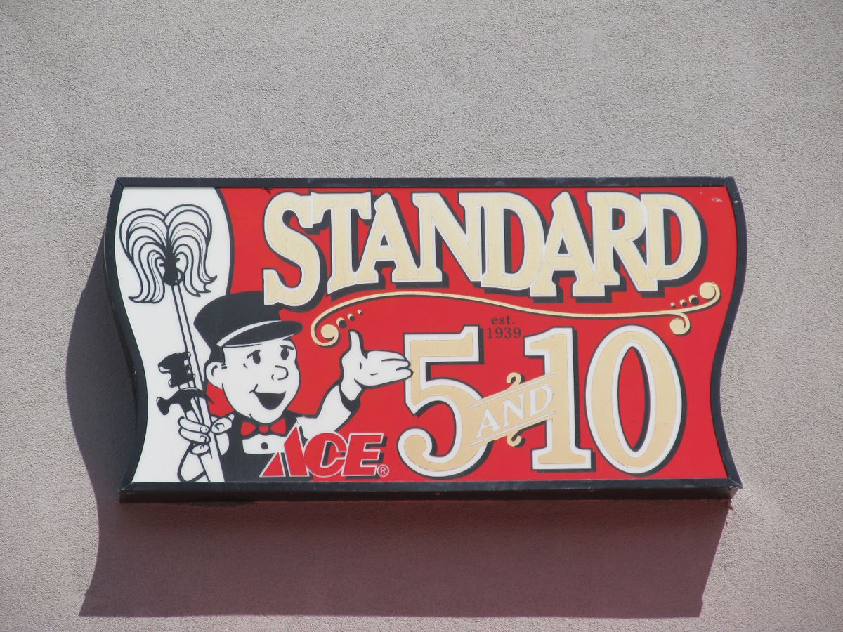 """A sign reading """"Standard 5 & 10."""""""