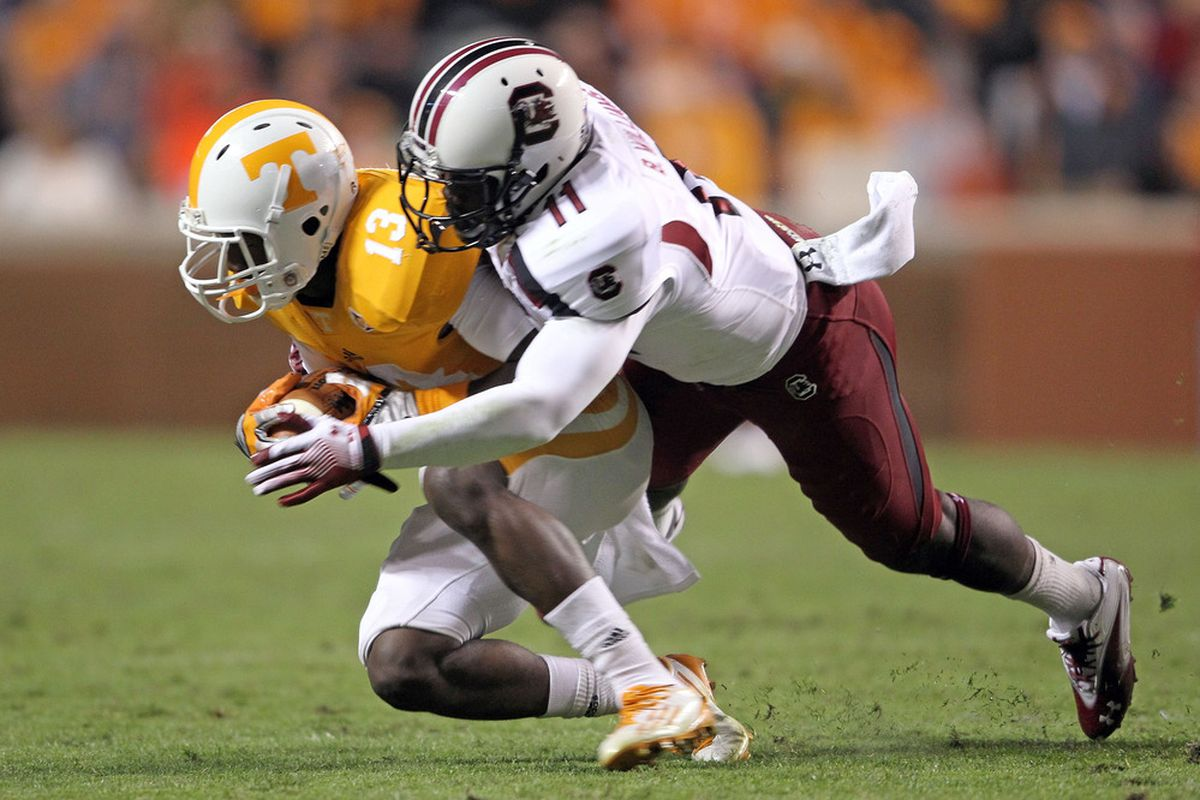 KNOXVILLE, TN - OCTOBER 29:  DeAnthony Arnett #13 of the Tennessee Volunteers is tackled by Brison Williams #11 of the South Carolina Gamecocks at Neyland Stadium on October 29, 2011 in Knoxville, Tennessee.  (Photo by Andy Lyons/Getty Images)