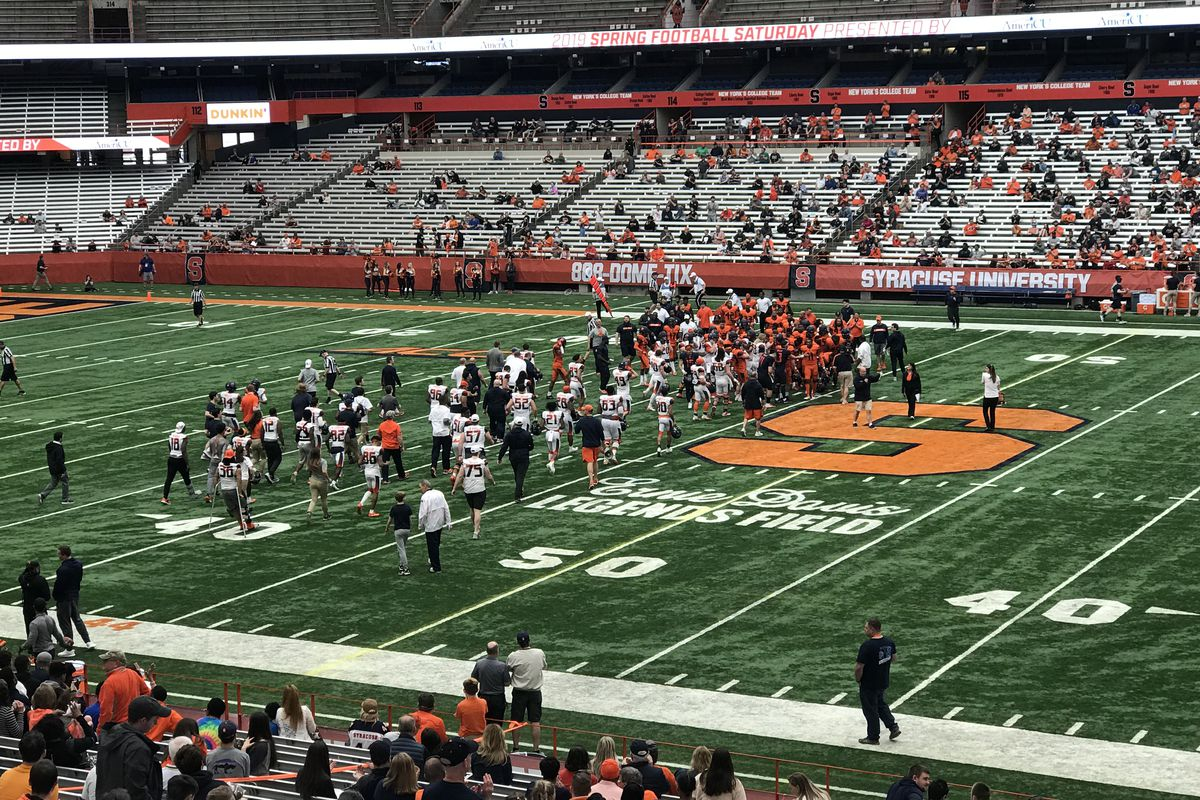 The Syracuse football team swarms onto the field in the Carrier Dome.