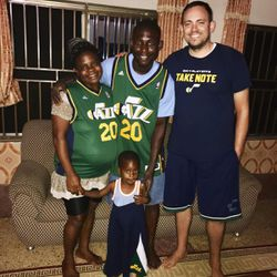 Zach Harding, right, poses with the Sarpong family (Isaac, Victoria and 2-year-old Stephen) as they sport their green Gordon Hayward jerseys and some basketball shorts. This family takes care of the World Joy's guest house Abomosu, Ghana, throughout the year.