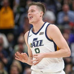 Utah Jazz forward Jonas Jerebko (8) celebrates after sinking a three during the game against the Golden State Warriors at Vivint Arena in Salt Lake City on Tuesday, April 10, 2018.