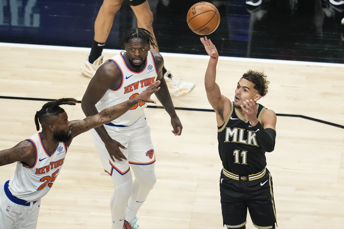 Atlanta Hawks guard Trae Young (11) shoots over New York Knicks forward Reggie Bullock (25) during the first quarter in game four in the first round of the 2021 NBA Playoffs at State Farm Arena.