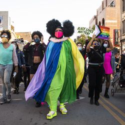 """Chicago drag performer Lucy Stoole (center) joins several black drag queens to lead the """"Drag March for Change"""" in the Boystown neighborhood on the North Side, Sunday afternoon, June 14, 2020."""