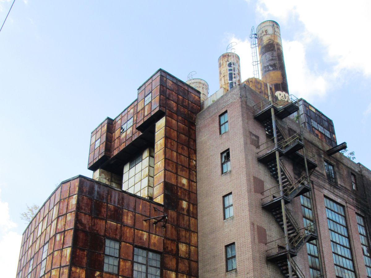 An abandoned steam plant in Philadelphia. The exterior is mostly red brick. The facade is decayed.