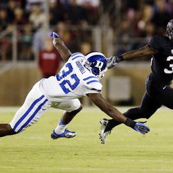 Stanford running back Stepfan Taylor, right, runs past Duke safety August Campbell during the first half of an NCAA college football game in Stanford, Calif., Saturday, Sept. 8, 2012.