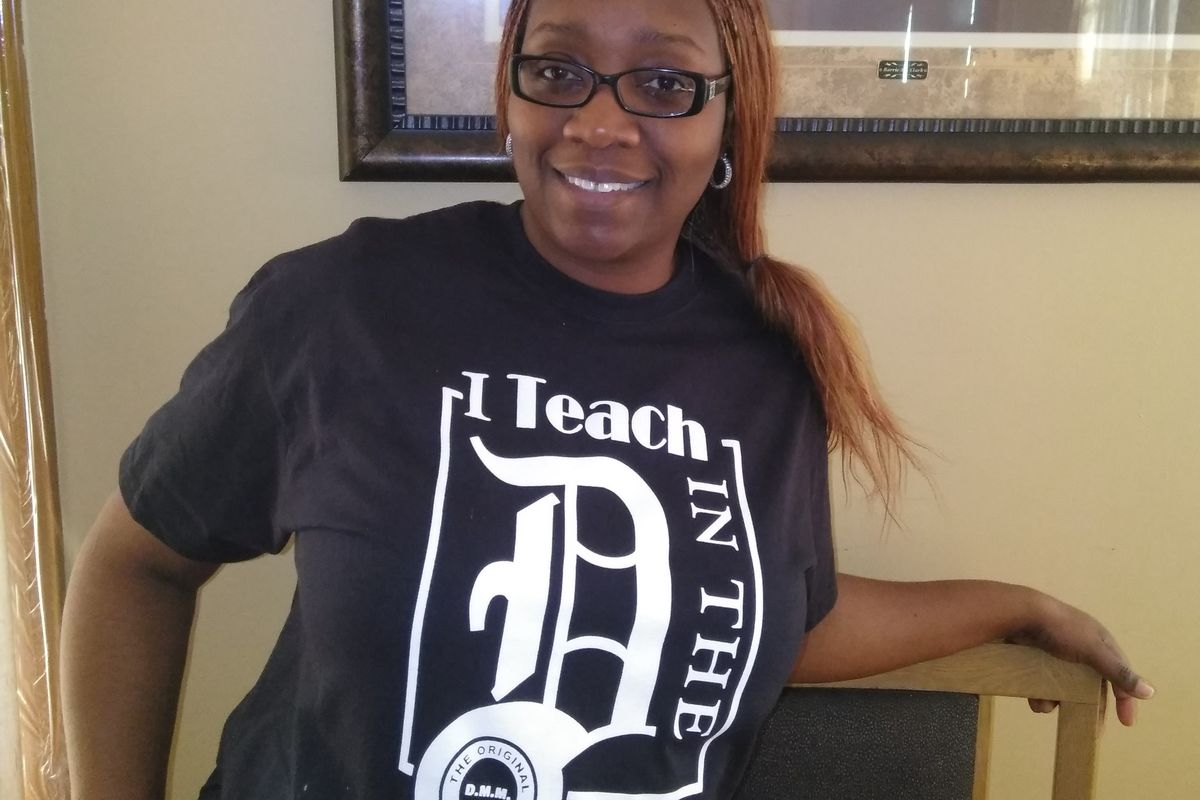 Dawn McFarlin, shown here wearing a shirt from her T-shirt company, is one of many Michigan teachers with a second job.