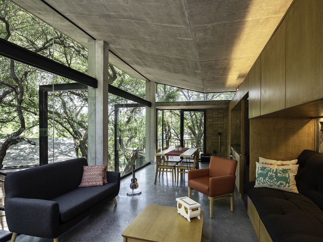 A modern, multi-level treehouse in the middle of a Mexican forest