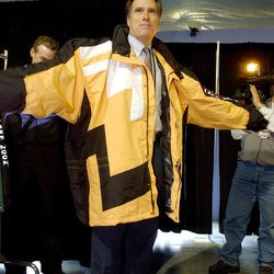 The Team processing center was opened Tuesday December 11, 2001. SLOC President and CEO Mitt Romney models a triple X sized coat as he explains that they are prepared to outfit even the largest of volunteers.