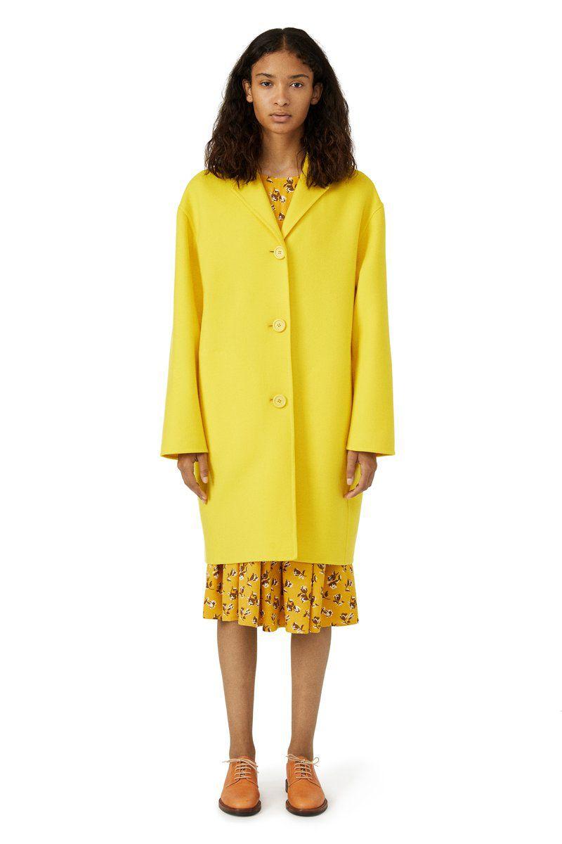 A model in a yellow wool coat